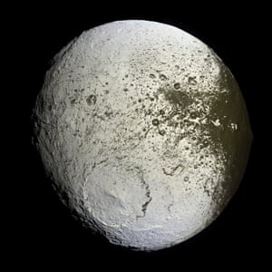 10 September 2007 This false-colour mosaic shows the entire hemisphere of Saturn's moon, Iapetus. Also shown is the transition region between the dark leading and bright trailing hemispheres. In many places, the dark material - thought to be composed of nitrogen-bearing organic compounds called cyanides, hydrated minerals and other carbonaceous minerals - appears to coat equator-facing slopes and crater floors. The distribution of this material and variations in colour will be crucial clues to understanding the origin of Iapetus' peculiar bright-dark dual personality.