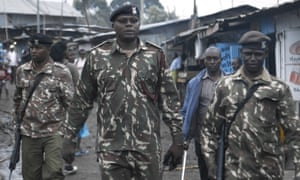 Insp Nick Sulwe leads officers on patrol in Kibera, May 2019. He warns that any incident could trigger an attack from residents or armed gangs.
