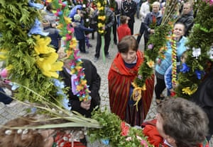 Villagers holding handmade palms wait for a procession in Glinianka, Poland