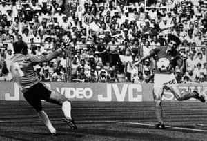 Italy's Paulo Rossi scores the first goal for his team, past Brazil's goalkeeper Valdir Peres.