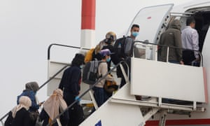 Vulnerable asylum seekers board a special flight in Athens, organised by the British and Greek governments to reunite them with close family in the UK