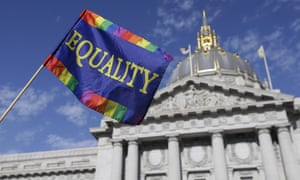 A fag is held up in front of City Hall in San Francisco,. The court's 5-4 ruling means the remaining 14 states, in the South and Midwest, will have to stop enforcing their bans on same-sex marriage. (AP Photo/Jeff Chiu)