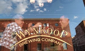 Wynkoop Brewing Company exterior shot of window with bar sign in it.