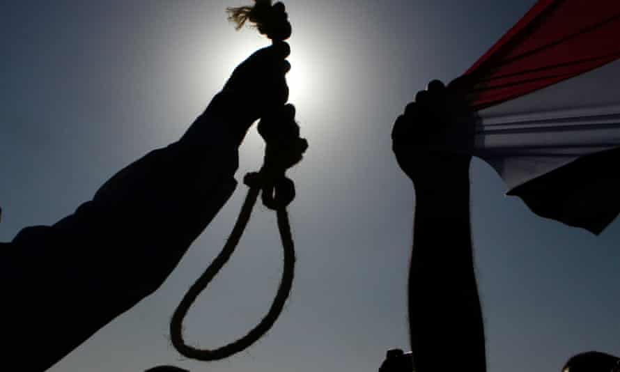An Egyptian anti-Mubarak protester holds a noose during a protest in Cairo