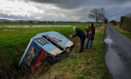 Stephen Fowler and Rachel Inman inspect a caravan during a tour of 'homeless haunts' in rural Somerset.
