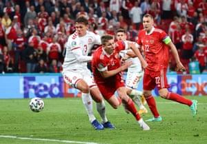 Aleksandr Sobolev of Russia is fouled by Jannik Vestergaard of Denmark leading to a penalty.