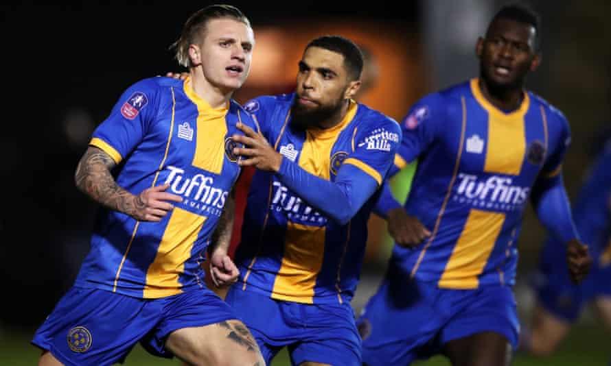 Shrewsbury Town's Jason Cummings (left) celebrates scoring his side's first goal against Liverpool