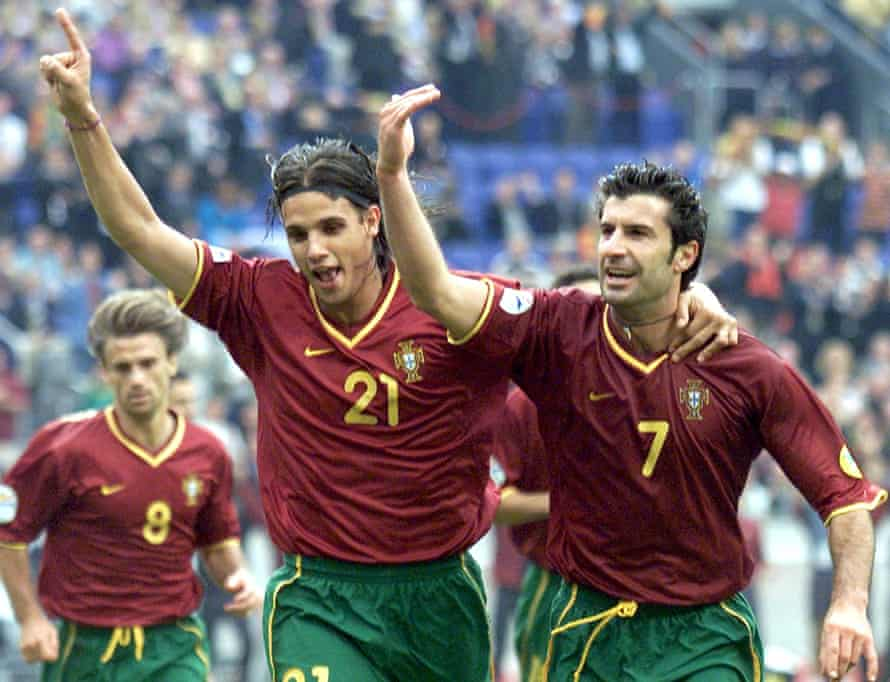 Portuguese players Luis Figo (r) and Nuno Gomes (l) celebrate after Gomes scored in the quarter-final match against Turkey in 2000.