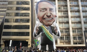 Supporters of Jair Bolsonaro put up a giant inflatable in his image outside his hospital in São Paulo, Brazil.