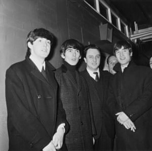 The Beatles pose with English comedian Ken Dodd backstage at Granada TV studios in Manchester, England on 25th November 1963.