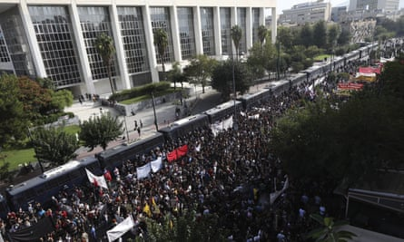 Protesters gather outside a court in Athens