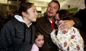 Fernando Arredondo of Guatemala reunites with his daughters Andrea, Keyli, and Alison, at Los Angeles international airport, 22 January 2020.