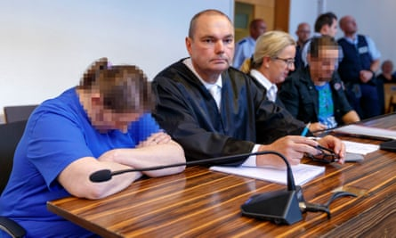 Berrin T (left) and Christian L (right) sit next to their lawyers