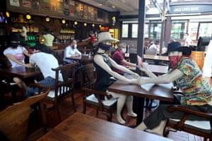 Mannequins sit in the Elpaso Bar in Ankara, Turkey.