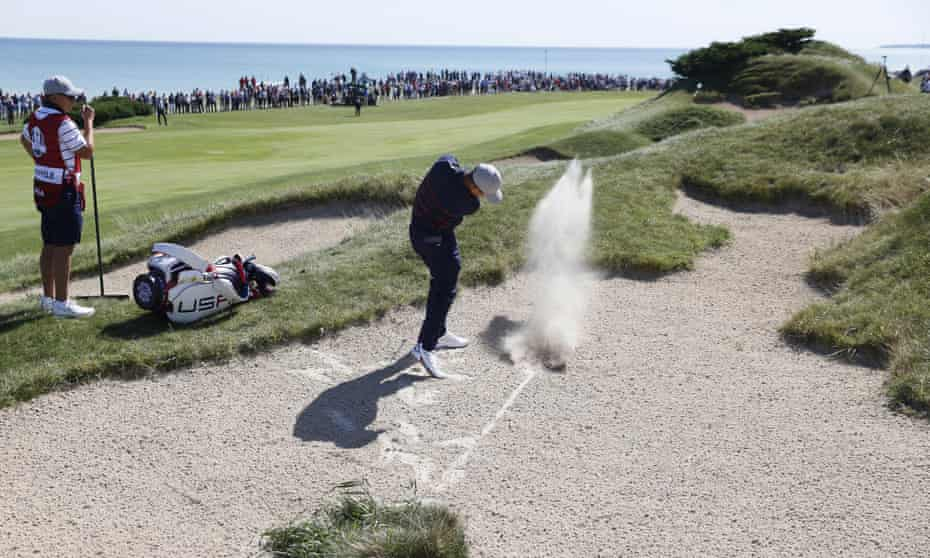 Xander Schauffele, who won both his matches on Friday, hits the second out of a bunker.