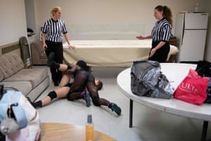 MCW referee Beckie Phillips (L) and another referee talk through Scott and Aria Palmer's match backstage in a makeshift dressing room at a firehouse in Galena, Maryland prior to Autumn Armageddon 2018.