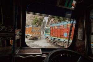 Drivers bathe at a waterfall midway up the Himalayan range