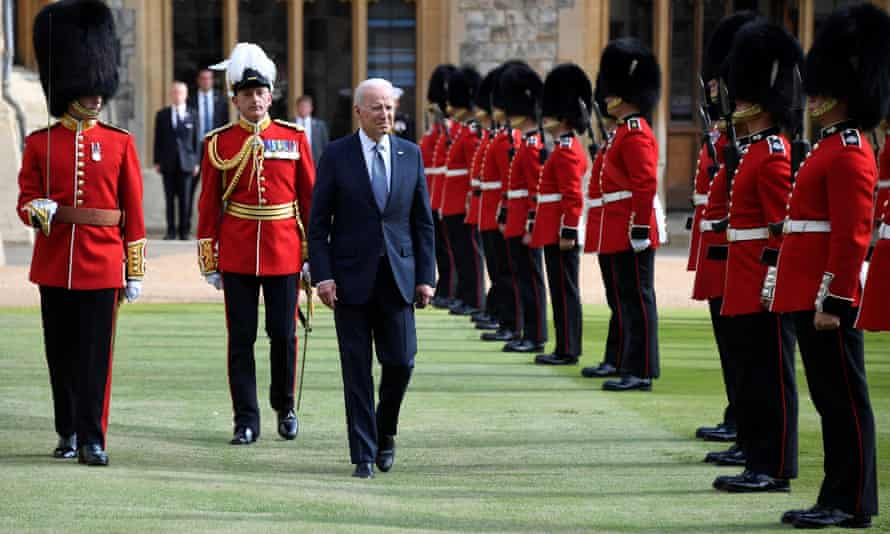 Biden inspects a guard of honour at Windsor Castle.