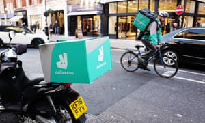 Deliveroo couriers in central London.