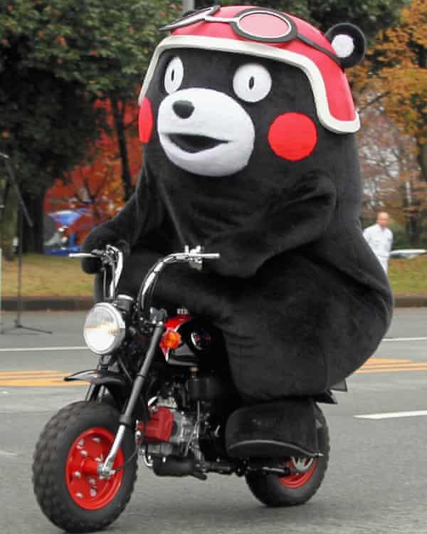 Kumamoto prefecture's official mascot Kumamon rides the Kumamon-themed scooter made by Honda.
