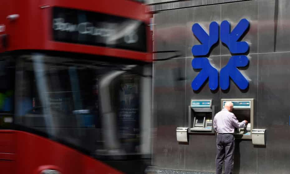 A man uses an ATM machine at a Royal Bank of Scotland branch in the City of London.