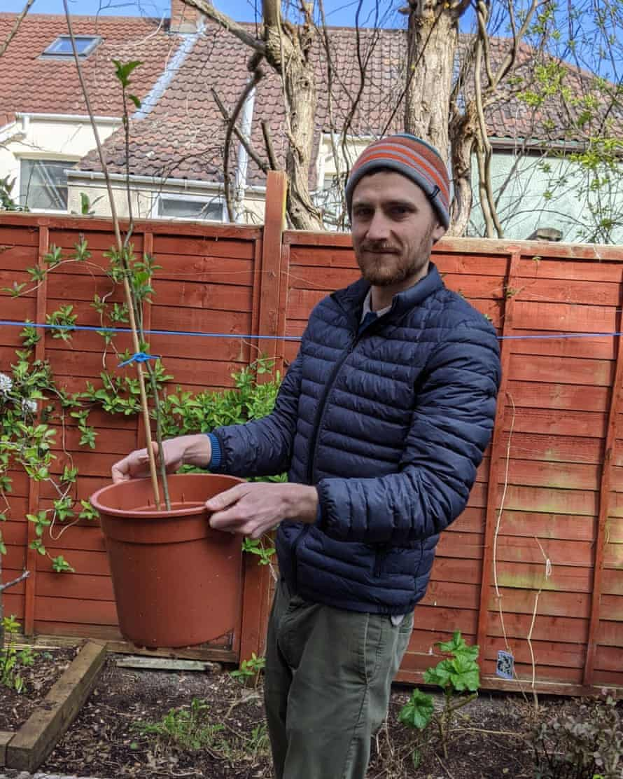 Tom Urry and the apple tree he has grown at home.