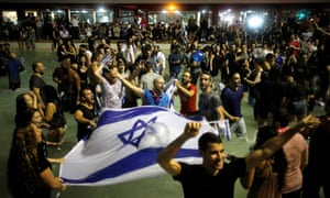Israeli fans celebrate at Rabin Square in Tel Aviv.