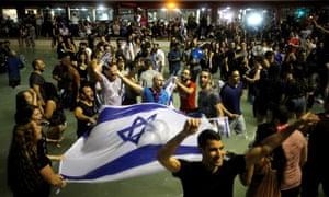 Fans celebrate in Tel Aviv after Israeli singer Netta Barzilai won the Eurovision Song Contest in 2018.