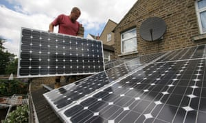Solar panels being installed on the roof of a house in South East London