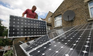 Solar panels being installed on the roof of a house in London