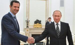 Vladimir Putin (right) shakes hands with Syria's Bashar al-Assad in the Kremlin in October.