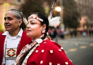 """Stephanie Big Crow, age 37 of the Oglala Lakota tribe and John Molina age 64 of the Yaqui / Apache tribe """"we march for indigenous women everywhere and for Standing Rock."""""""