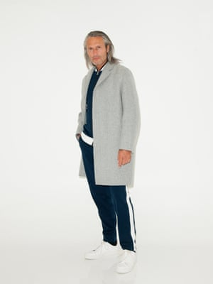 Grey overcoat Cos, dark blue and white track suit trousers and jacket Bjorn Borg, white trainers Aldo