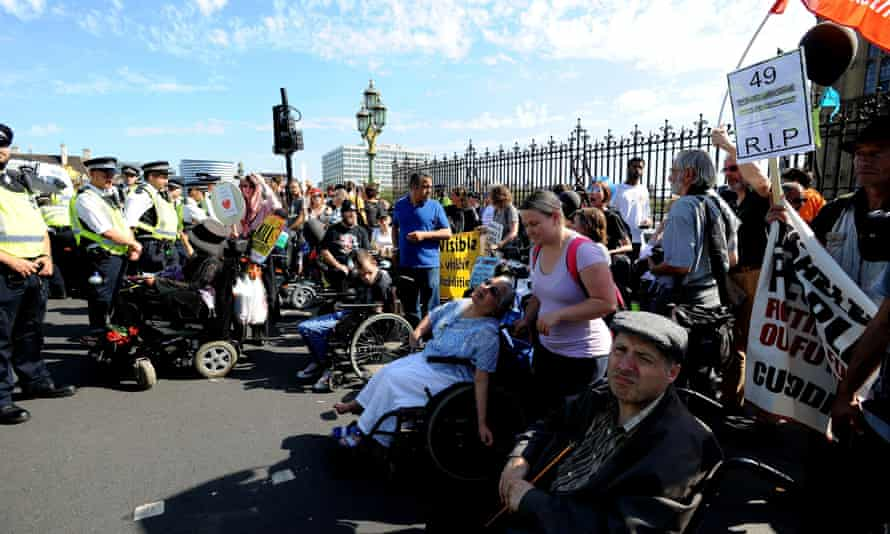Protesters block part of Westminster Bridge in central London as they demonstrate against disability benefit cuts.