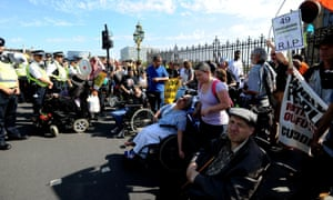 Protesters gather outside Westminster to demonstrate against disability benefit cuts.