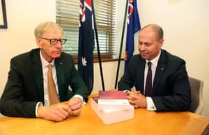 Commissioner Kenneth Hayne and Treasurer Josh Frydenberg with the final report from the royal commission into misconduct in the banking, superannuation and financial services industry on 1 February 2019.