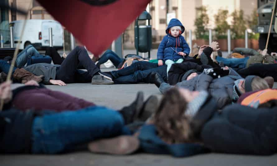 Climate protesters outside the EU parliament in Brussels demand it declares a climate emergency.