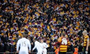 """Bradford fans wave flags at Wembley."""