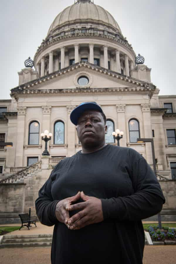 Kelly Mallett, recently released from the Mississippi State Penitentiary, poses outside the state capitol in Jackson