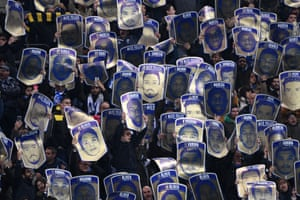 The fans of Porto keep portraits of their players from kicking off.