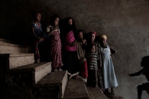 Girls pose for a photo at a school turned into a camp for displaced people in Khanfar, Yemen