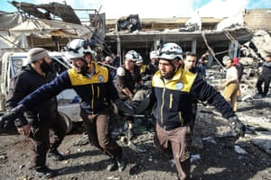 Marratinnuman, Syria, White Helmets and locals conduct search and rescue works at a debris of a building after Assad Regime forces carried out airstrikes that targeted a marketplace in Idlib which is a part of a de-escalation zone,
