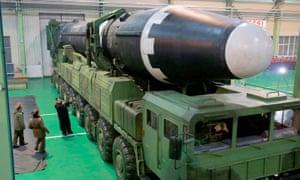 Kim Jong Un is seen with the newly developed intercontinental ballistic rocket Hwasong-15