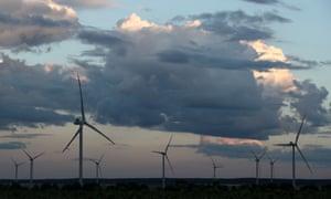 wind turbines under cloudy sky