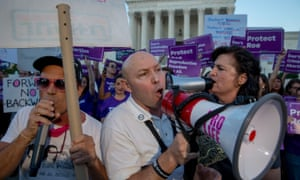 Pro-choice and anti-abortion protesters demonstrate in front of the supreme court on Monday.