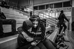 Jaguars junior Dion Brown sits his girlfriend Lakenya Thomas as they watch a junior varsity game in a nearly empty gym, 24 February 2020