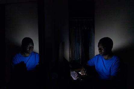 Okello does his homework in his room after his kids go to bed.