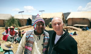 'It's a celebration of life, of other people' … Robinson with one of the Uros people who live on floating islands on Lake Titicaca.