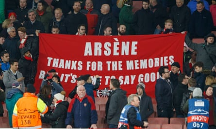 Arsenal fans hold up a banner at the 5-1 defeat to Bayern Munich