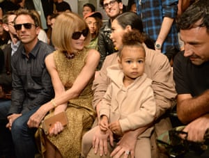 Sharing the front row with Kim Kardashian West and her daughter North West at the Yeezy season two show in New York, 2015.